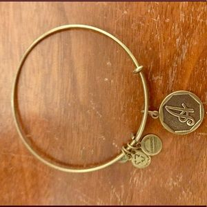 "Alex and Ani brass ""A"" bangle."